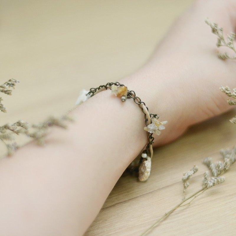 a handmade vintage chains bracelet with Rutile Quartz by niyome craft.