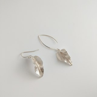 Hand-forged a pair of asymmetric sterling silver leaf earrings