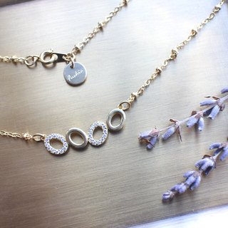 Sweet circles-zircon brass necklace