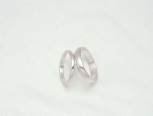 Ni.kou couple of semi-circular sterling silver ring