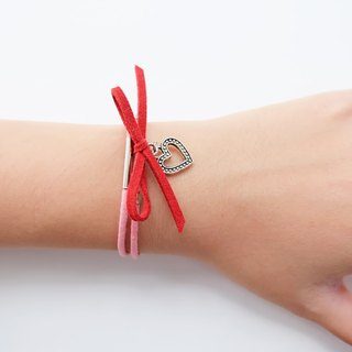 Red bow and heart charm pink cord bracelet