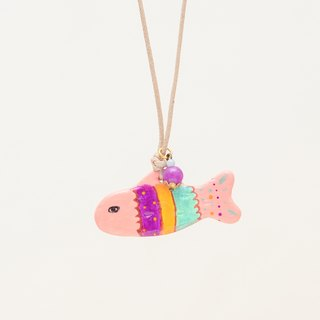 a little pink boho fish handmade necklace from Niyome clay.