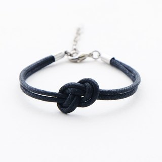 Infinity bracelet in black , waxed cotton cord