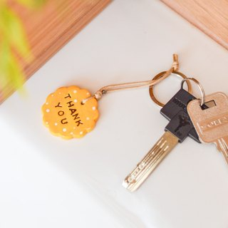 "The yellow key chain(key ring) with the word "" Thank you """