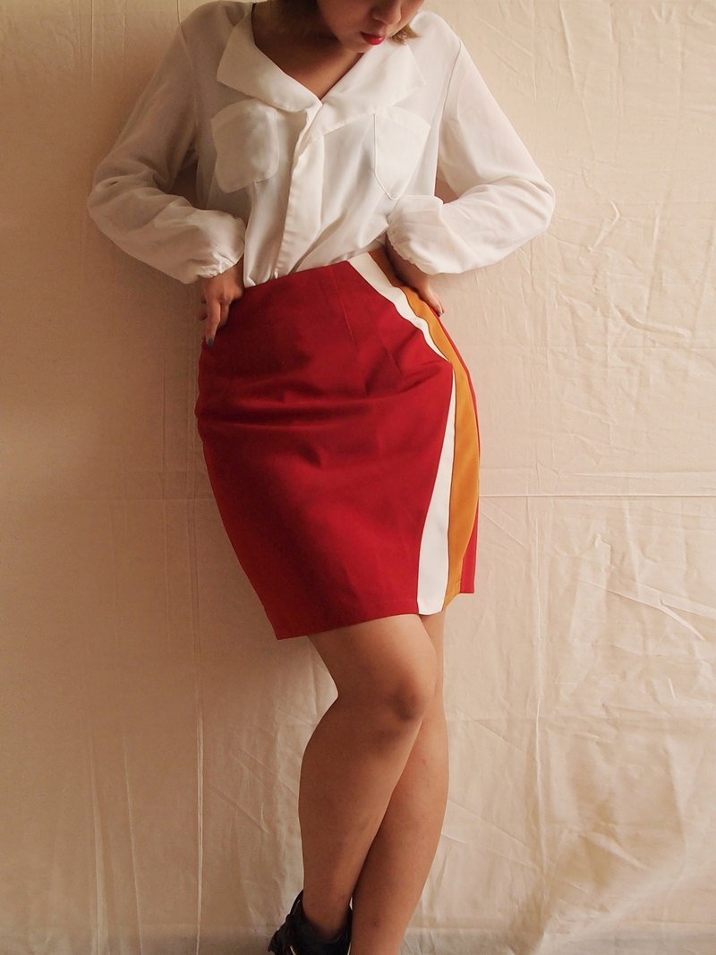 A good proportion of stitching a red mini skirt