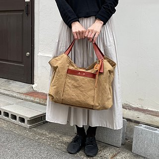 tanton - tanned dyed canvas × leather bag