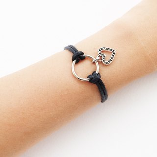 Black cord bracelet with circle and heart charm