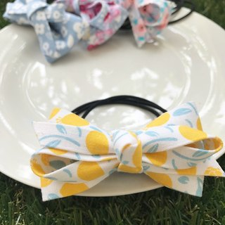 Yellow fruit knot hair bundle