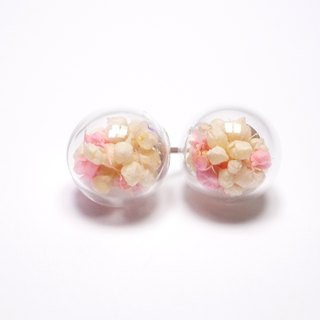 A Handmade pale pink glass ball earrings with white stars