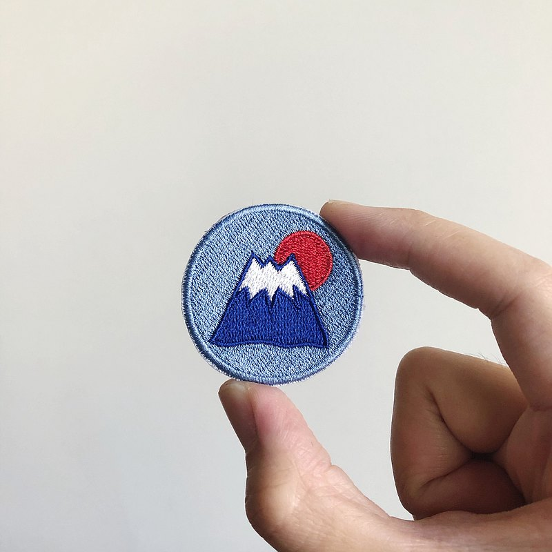 A world-weary Mount Fuji embroidery brooch or embroidery piece