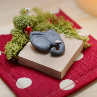 a little elephant head handmade brooch from Niyome clay.