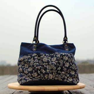 A portable candy bag - dark blue handle elegant Milan flower