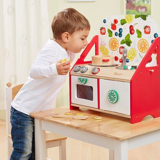 Little chef. Desktop wooden toy kitchen