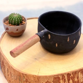 3.2.6. studio: Handmade ceramic coffee cup with wooden handle.