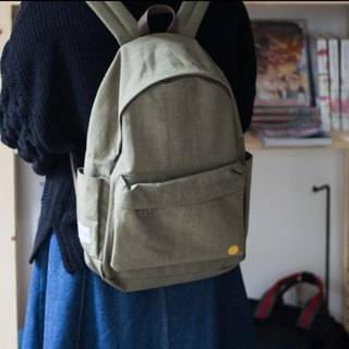 Small day army green warm sun wrinkled backpack