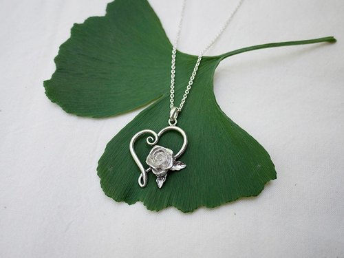 """Gift of love"" handmade sterling silver pendant"