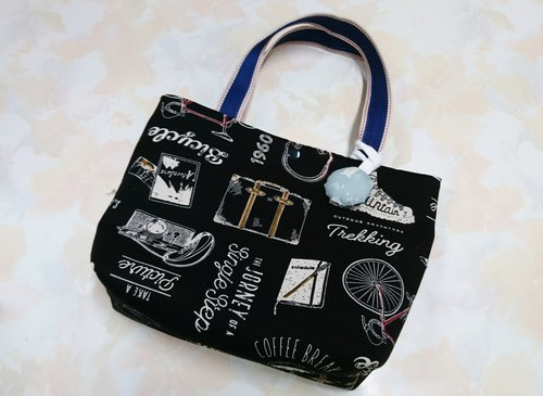 Black travel suitcase, bike pattern handbag