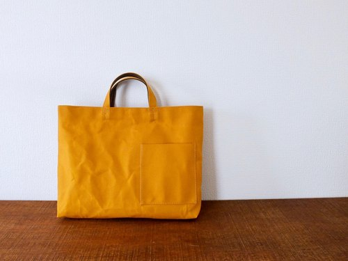 Reprint Okeiko (thin tote of paraffin-processed canvas)