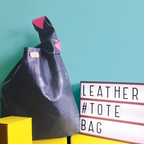 Sonniewing's Playful Black Leather Shopping Bag