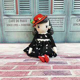 Handmade doll in red hat