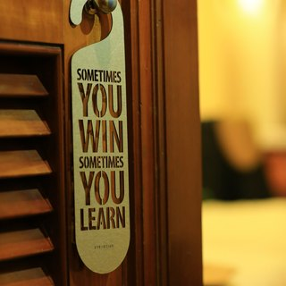 "[EyeDesign see design] a word door hanging ""SOMETIMES YOU WIN SOMETIMES YOU LEARN"" D28"