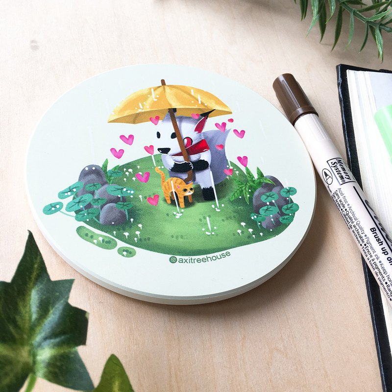 White fox sizzling ceramic round coaster in the rain