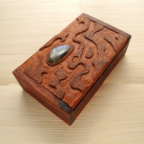 Wooden carved box with labradorite.