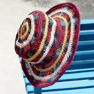 A limited edition handmade cotton cap / hat / visor / hat - rendered hollow rainbow colored knit