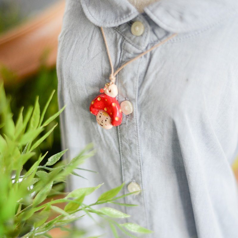 a little red mushroom boy handmade necklace from Niyome Clay.