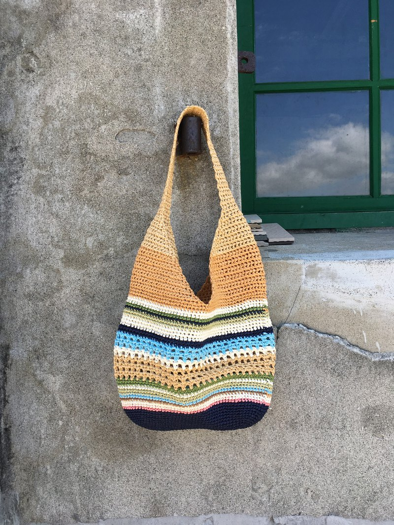 The coastline of Maldives. Hand-woven paper grass shoulder bag