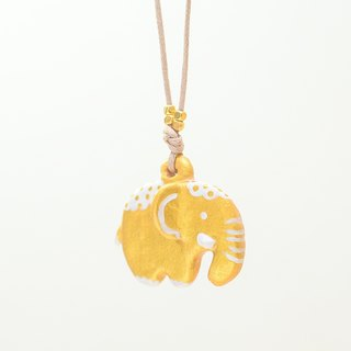 a little golden elephant handmade necklace from Niyome clay.