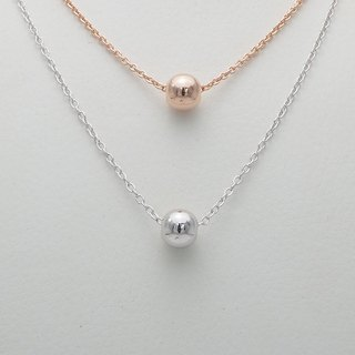 Single floating silver bead necklace