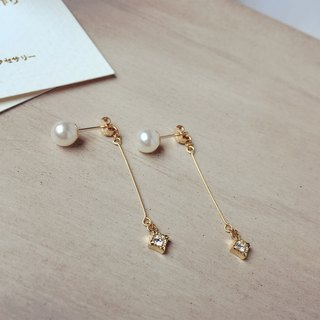 Diamond pearl earrings drape
