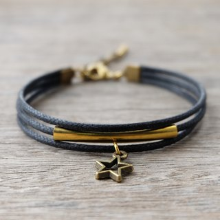 Black waxed cord bracelet with brass star
