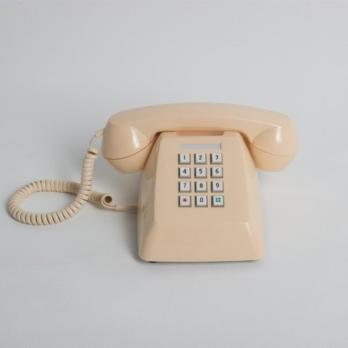 70s Vintage cream on old phone