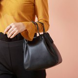 Clyde Cloud XS leather bag in black.