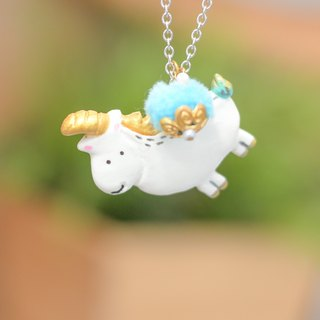A cute unicorn character with pom pom handmade necklace from Niyome Clay