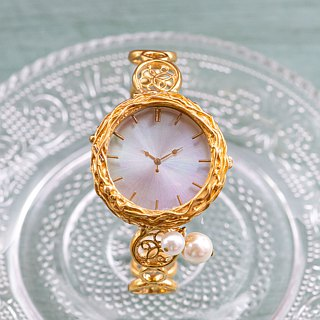 Bangle type watch of aurora and pearl M