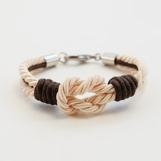 Cream tie the knot bracelet with dark brown waxed cotton cord