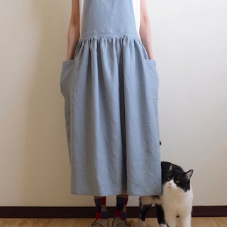 Everyday hand-made clothes live in the heart of a little girl gray blue straps work apron linen