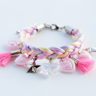 Pink/lilac/yellow braided bracelet with charms