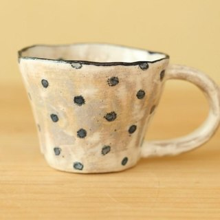 Cup of pulverized hand drawn blue dots.