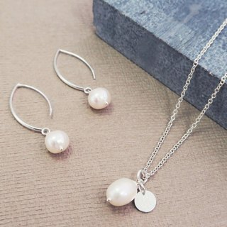Sterling silver natural pearl earrings elliptical arc hanging design
