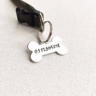 found / bone-shaped dog ID tag