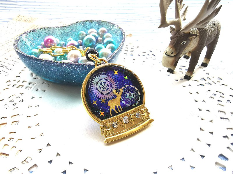 The magical story is lost in the crystal ball. Hand-made resin key ring