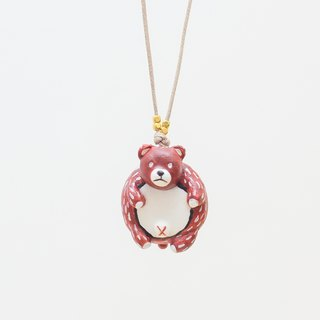 a little brown bear handmade necklace from Niyome clay.