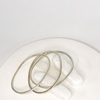 Set of three oval handmade silver bangles with different textures (B0036)