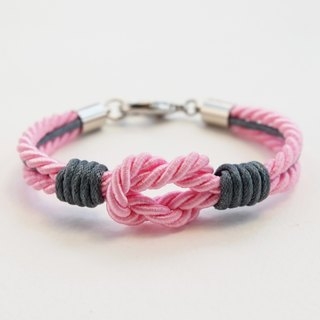 Light pink tie the knot bracelet with gray waxed cotton cord