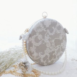 New delicate lace print elegant small round bag pearl bow three-type portable oblique shoulder single shoulder gold bag