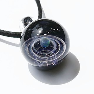 The world of purple. Glass pendant with green opal Star planet universe
